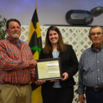 Acting NRCS State Conservationist Jackie Byam presents Donnie Bowen and Leslie (Page) Bowen with a citation